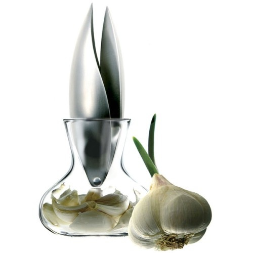Garlic press by Danish company Eva Solo. The glass bowl with the press sticking out of the top was designed to be reminiscent of the bulb of garlic itself.