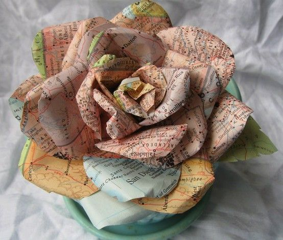 "handmade paper rose ... upcycled maps ... my idea: if the map isn't a pretty color, lightly stain it with watercolor wash or ""age"" it with coffee stain ..."