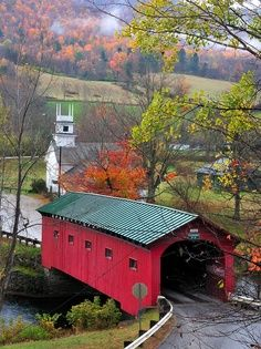 Pretty covered bridge leading to a beautiful country scene