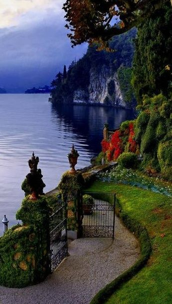 Gate opens to Lake Como, Italy.