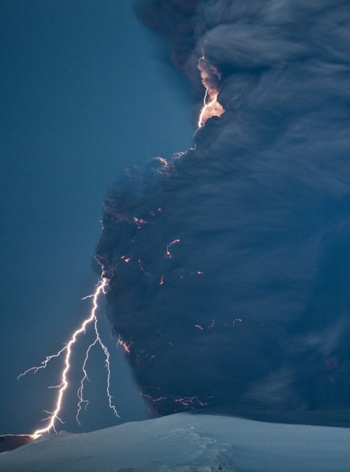 **The first of 3 photos by Olivier Vandeginste, taken 10 km east of Hvolsvollur at a distance 25 km from the Eyjafjallajokull craters on April 18th, 2010. Lightning and motion-blurred ash appear in this 15-second exposure. (© Olivier Vandeginste) #
