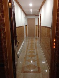 Hallway granite tile design