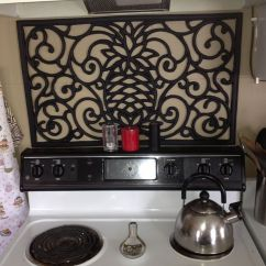 Kitchen Wall Splash Guard Cream Colored Painted Cabinets Stove