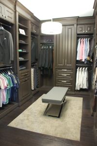 custom walk in closet with Croc ottoman