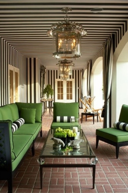 What an elegant porch... Painted stripes layered with striped curtain panels and the pop of green!