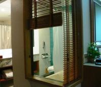 Weird bathroom, has a window looking on the room ...
