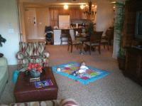 Living room, kitchen, and dining area of 3 bedroom suite ...