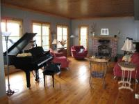 The grand piano and the fireplace in the living room ...