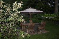 Backyard picnic table - Picture of By The Park Bed and ...