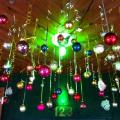 Christmas decorations hanging from the ceiling as you walk through the