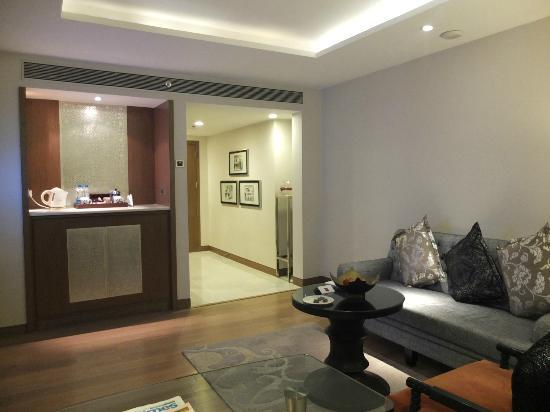 living room mini bar colour schemes grey and blue view from of suite to entrance area itc mughal agra a luxury collection hotel