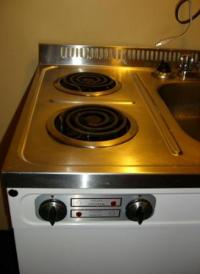 Kitchenette stove. Part of sink/stove/fridge unit ...