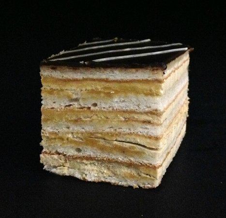 Tipical belgian dessertJavanais almond based cake with coffee buttercream  Picture of La