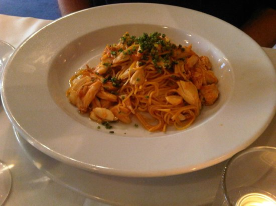 Saffroninfused crab pasta in spicy red sauce  Picture of