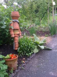 This flower pot man guards the entrance to one of the ...