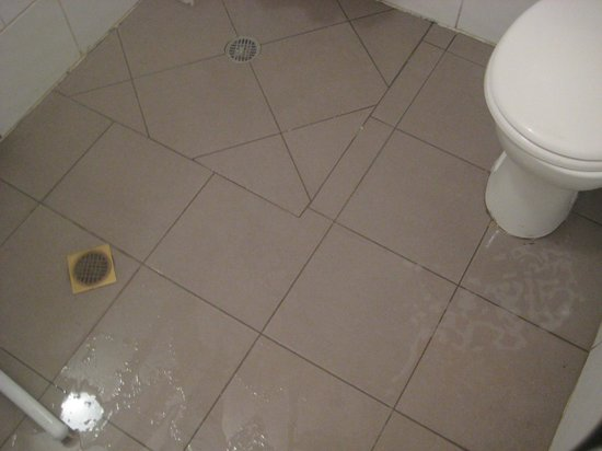 Wet bathroom floor  Picture of Florentine Hostel Tel