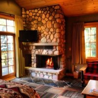 Wood Burning Fireplace - Picture of Alpine Village Cabin ...