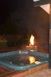 Hot tub and fire pit. - Picture of Good Medicine Lodge ...