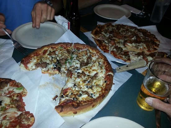 One of the 3 pizzas we ordered  Picture of Nellos Pizza