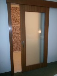 Sliding frosted glass bathroom doors. Really nice ...