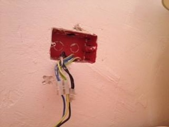 Electrical Wiring Hanging Out Of Wall In Room At Riu