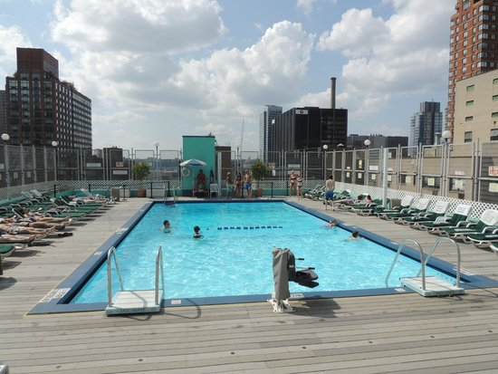A view of the rooftop pool  Picture of The Watson Hotel