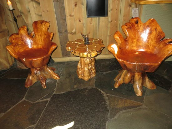 tree stump chairs steel airport chair carved and tables in little nooks picture of aegir brewpub