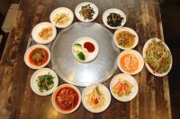 A Korean Royal Cuisine table setting with 12 different ...