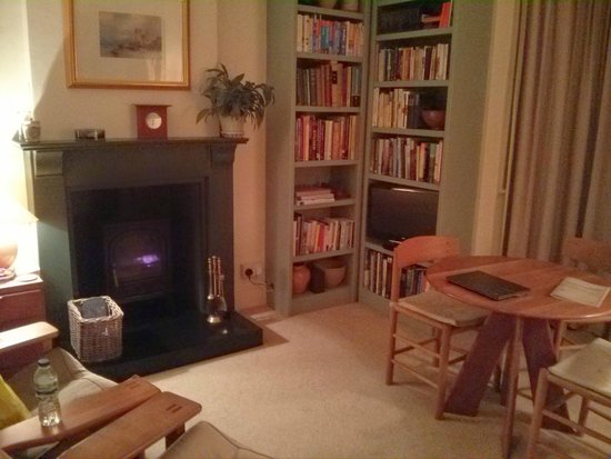 cosy living room with log burner mini bar design in the beautifully complete picture at 24