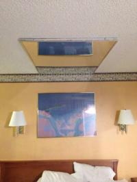 Mirrors on the ceiling above the bed. Classy...
