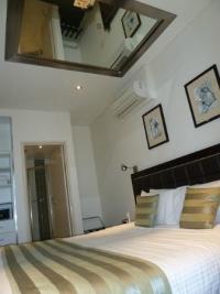 master bedroom w ceiling mirror
