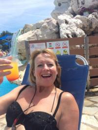 My wife enjoying a tequila sunrise at the main pool ...
