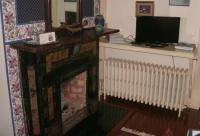 TV, fireplace, radiator, wine glasses -- and a personal ...