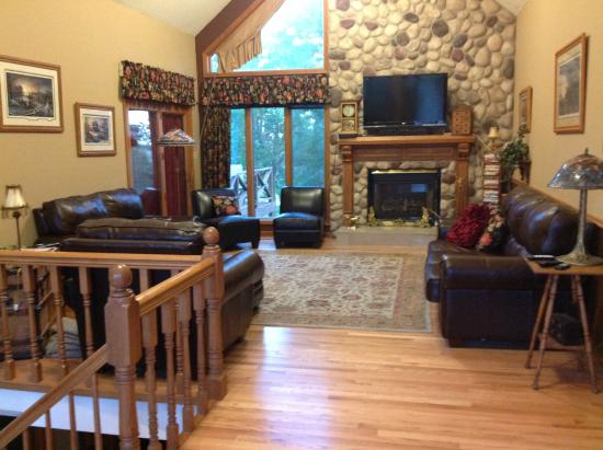lodge living room furniture accent pieces upstairs with leather fireplace and large tv adams street country
