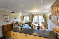 Open plan kitchen diner and sitting room with patio doors ...
