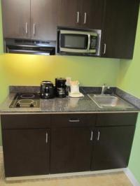 Kitchenette View of Stove Top & Microwave - Picture of ...