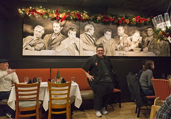 Kitchen Consigliere Cafe Chef Angelo Standing Front Mural