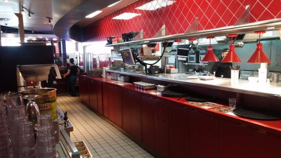 kitchen server round wooden table area picture of red robin gourmet burgers rancho