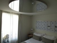 mirror on ceiling over bed