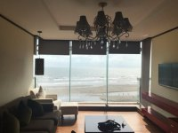 Living room area with panoramic ocean view - Picture of ...