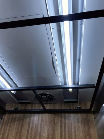 Inside Of Elevator No Covers For The Fan And Lights