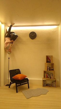 chair upside down on wall large swivel picture of house kuching