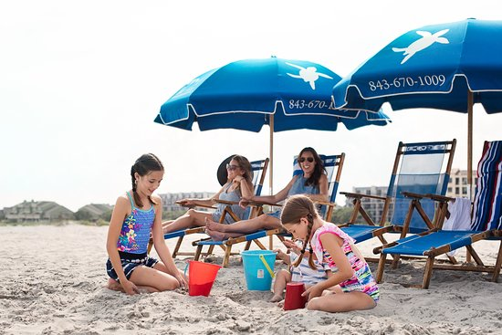 beach chair rental isle of palms used portable dental umbrella rentals keep you cool so can play longer picture company