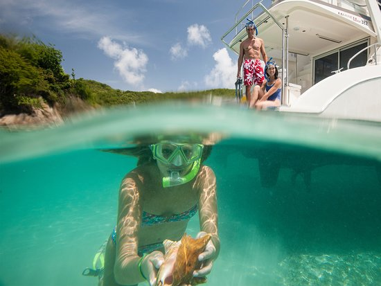 girl snorkeling in the