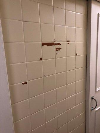 peeling paint on painted bathroom tiles