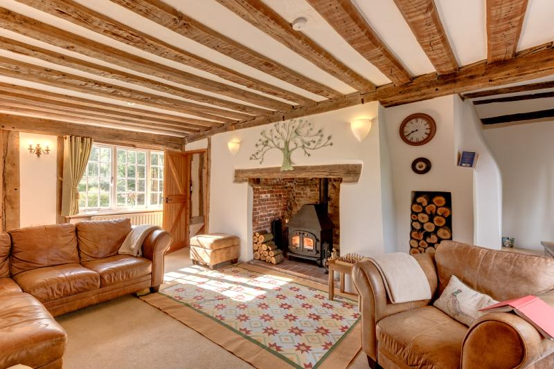 cosy living room with log burner small seating arrangements cocketts a peaceful historic retreat in the heart of suffolk sitting large inglenook and wood