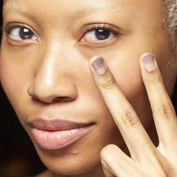 """Don't let it fool you: A sheer wash of gray at the tips actually looks delicate, like watercolor, but the nails at Monse were meant to look as though they'd been """"dipped in petroleum."""" The shades used here? Manicurist Madeline Poole mixed Sally Hansen's Commander in Chic and Au Nature-al."""