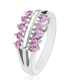 Inel de culoare argintie, braţe despicate, două linii de zirconii violet deschis