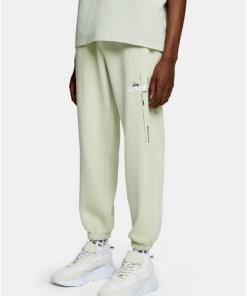 Jogginghose mit 'Independent'-Print und Überfärbung, salbeigrün, SALBEI