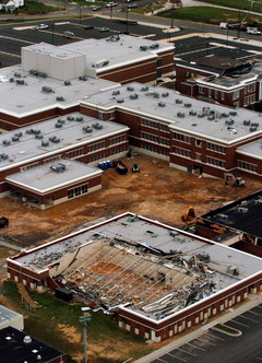 Part of the damage to Albertville High School is seen here, while adjacent Albertville Middle School also received major damage. -Huntsville Times photo by Eric Shultz